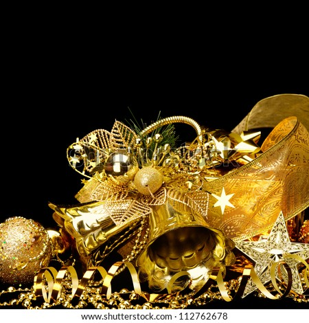 Gold Christmas decorations. Boxes, ribbons, stars, bells on black background
