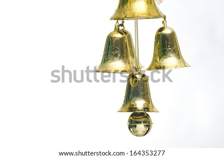 Gold christmas jingle bells. Isolated on a white background.