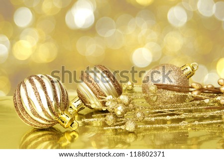 Gold Christmas scene with baubles and abstract light background