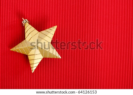 Gold Christmas star over red background. Xmas Card