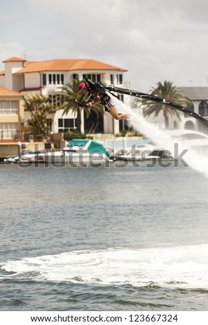 "GOLD COAST  AUSTRALIA  JAN  1: Unidentified man flying  with  one of the first kind ""Water Jet Pack""  in the warm waters of Gold Coast Queensland on Jan 1  2013 Australia.  ."