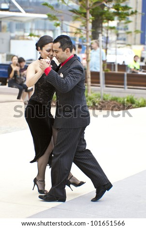 GOLD COAST - AUSTRALIA - 18 MARCH: Unidentified pair dancing tango on Japan & Friends Day festival. 18 March 2012 on Gold Coast, Australia. Street dancers performing tango