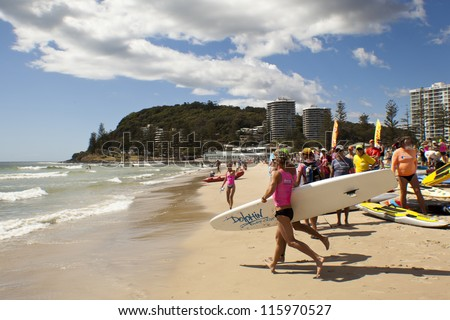 GOLD COAST,  AUSTRALIA  - SEPT 14 2012 : Unidentified participants  in the Colangatta Gold life saver compotation  on Sept, 14, 2012 in Gold Coast Australia, . - stock photo