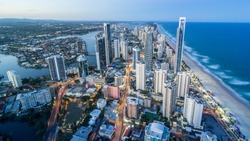 Gold Coast Beautiful Panorama Aerial view of Surfers Paradise City Skyline Cityscape with Light Trails from Q1 Building at dusk in summer Sunset, Australia