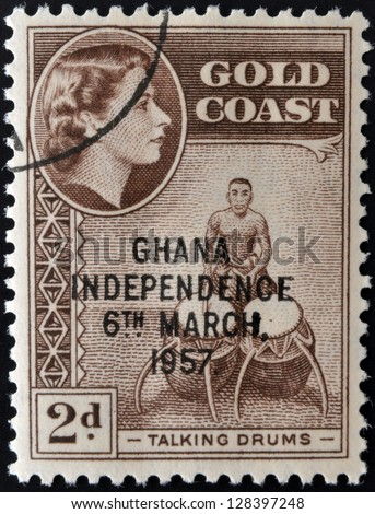 GOLD COAST - CIRCA 1952: A stamp printed in Gold Coast shows Queen Elizabeth and talking drums, circa 1952