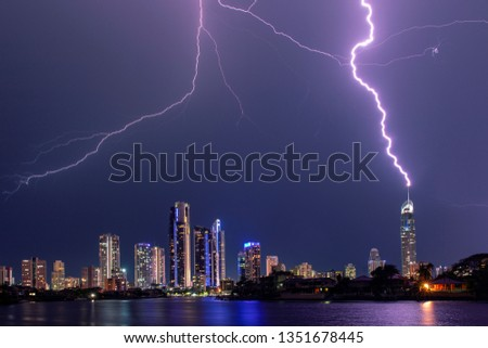 Gold Coast skyline being lit up with lightening bolts and a direct hit on the Q1 building, view from Evandale Park