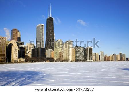 Gold Coast winter time - seen accross frozen Lake Michigan. - stock photo