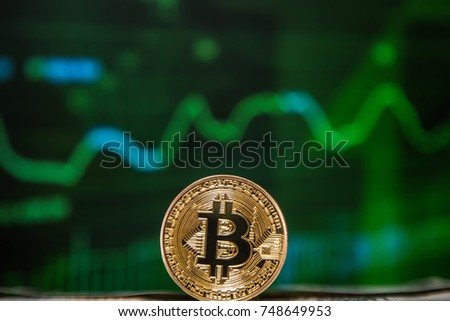 gold coin bitcoin against the background of the chart of currencies and stocks #748649953