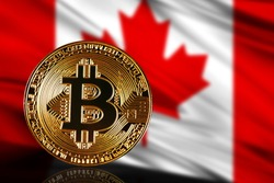 gold coin bitcoin on a background of a flag Canada