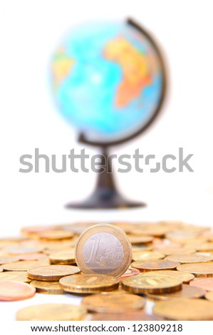 Gold coins and globe. On a white background.