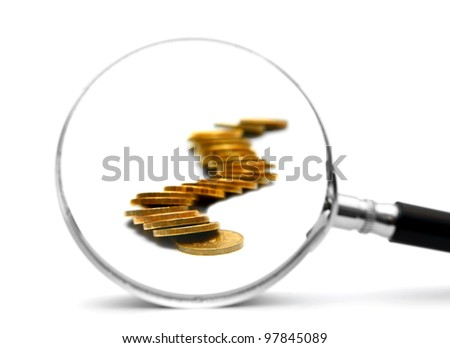 Gold coins and magnifier. On a white background.