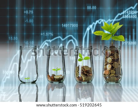 Gold coins and seed in clear bottle on Stock market exchange data on LED display background, Business investment growth and trading concept