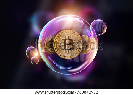 Gold Coins Bitcoin in a soap bubble. The concept of instability of the crypto currency, electronic money, the burning of the crypto currency. against a dark background