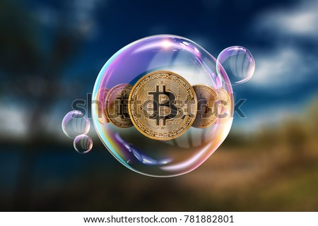 Gold Coins Bitcoin in a soap bubble. The concept of instability of the crypto currency, electronic money, the burning of the crypto currency.