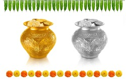 gold coins filled in gold pot (kalash) and silver coin filled in silver pot (kalash) an mango leaf thorana and marigold flowers for hindu festivals and poojas