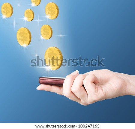 Gold coins flying to modern mobile phone holding by hand, e-business concept