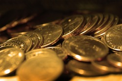 Gold coins in piles and stacks representing riches and wealth