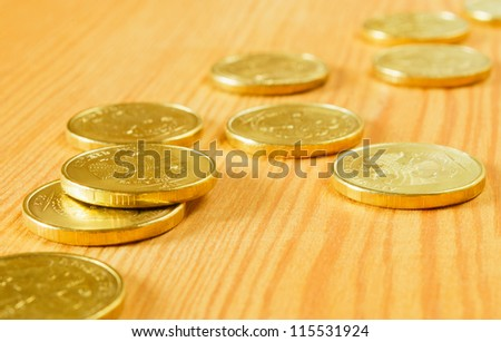 Gold coins of the table, close-up.