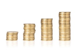 Gold coins stacked on a white background. Money saving concept