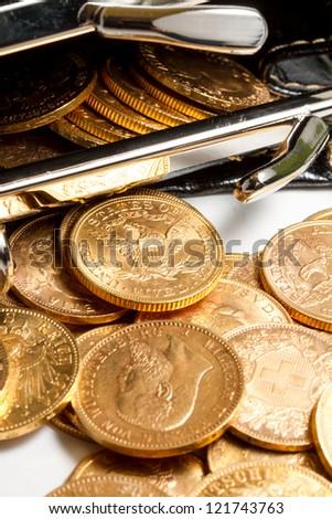 Gold coins treasure in purse - stock photo