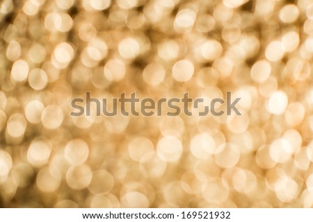 Gold color shiny ornaments bokeh. Blurred background