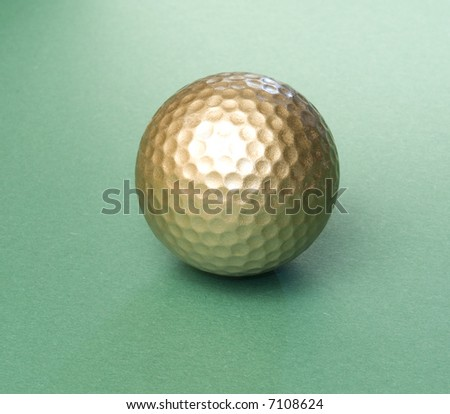gold-colored golfball