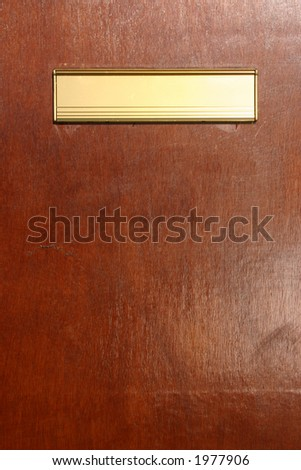Gold colored letterbox.