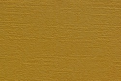 Gold colored plain textured cardstock background image. Color swatch shade with copy space.