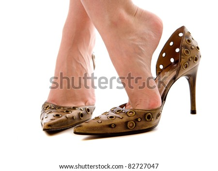 gold colour high heels shoes a slips foot out