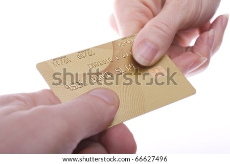 Gold coloured credit card being passed over. Branding and number removed for security.