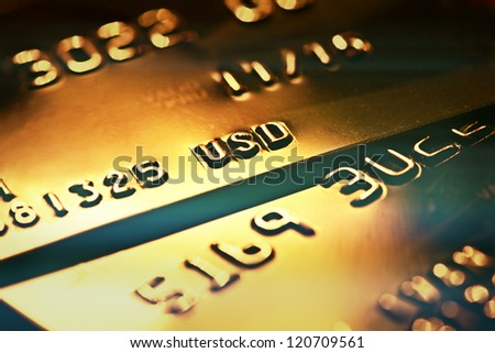 Gold credit card. Macro image