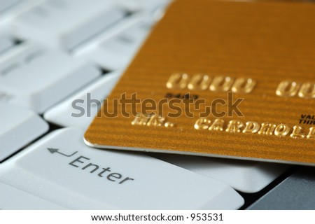 Gold Credit Card on a Keyboard. Close-up.