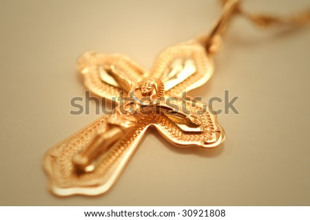 gold cross with crucifix closeup