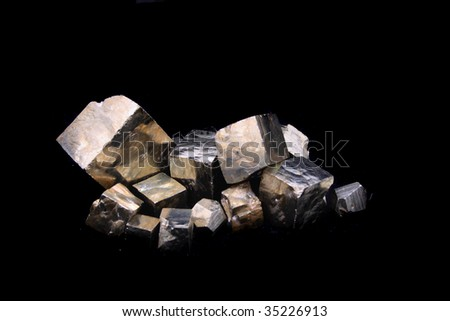 gold cubes isolated on the black background