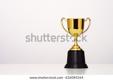 gold cup on white background.
