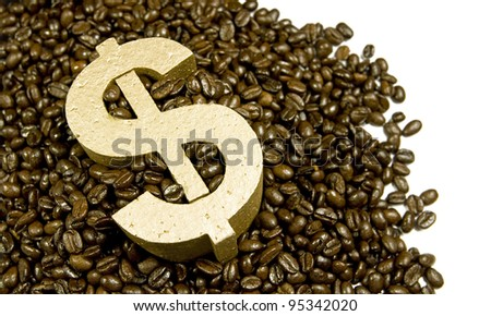gold dollar in a pile of coffee beans spilling onto white background