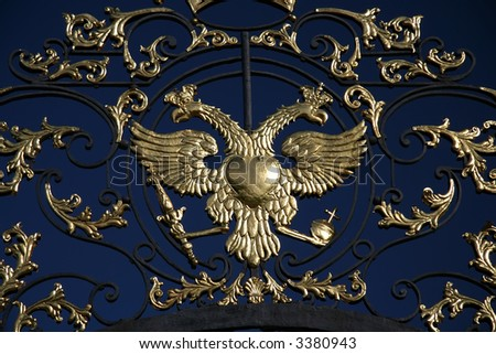 Gold double eagle on gate of Ekaterininsky Palace in Pushkin, Saint-Petersburg, Russia
