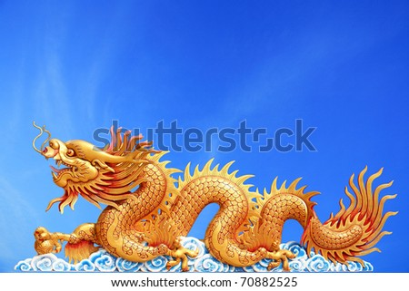 gold dragon with blue sky background