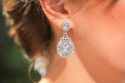 Gold earring with diamond. Diamond earring. Jewelry earring.