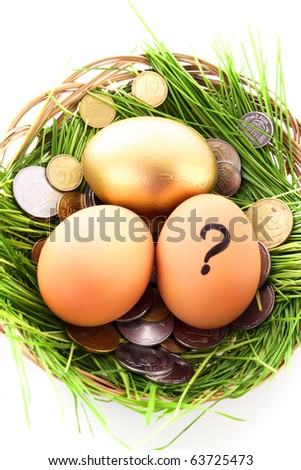 Gold  egg in nest. Ukrainian coins
