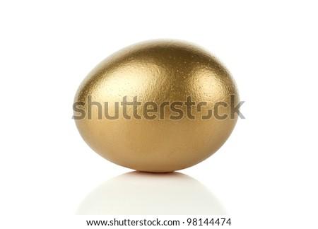 Gold egg isolated on white background - stock photo