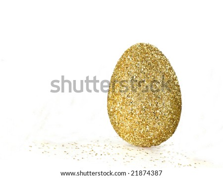 gold egg on white background, copy space