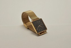 Gold elegant watch with square face