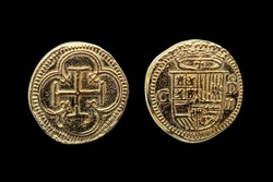 Gold Escudos replica coin replica of Philip II (Felipe II) of Spain Crowned Shield Obverse Cross In Quatrefoil Reverse cut out and isolated on a black background stock photo Image