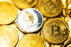 Gold ethereum coins among bitcoins on a golden background. Trading on the cryptocurrency exchange. Cryptocurrency Stock Market Concept. Virtual money concept. Mining or blockchain technology.