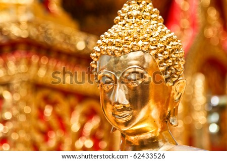 Gold face of Buddha statue in Doi Suthep temple, Chiang Mai, Thailand.
