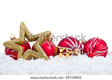 Gold five pointed star and red ball christmas decoration on snowflakes background