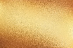 Gold flakey foil texture used as background