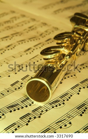 Gold Flute and notes in background. Classic music concert concept