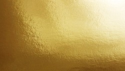 Gold foil gradient texture background with uneven surface